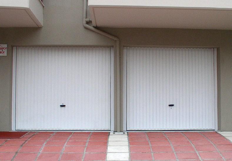Ρολά Γκαραζόπορτες στο Περιστέρι : Α. & Σ. Μενούνος Ρολό Γκαραζόπορτα, Βιομηχανικές Πόρτες, Δικτυωτά Ρολά, Συρόμενες – Ανοιγόμενες Πόρτες, Γκαραζόπορτες Οροφής, Ρολά Αλουμινίου, Μηχανισμοί Οροφής, Μπάρες Στάθμευσης, Αυτοματισμοί, Φωτοκύτταρα Ασφαλείας, Πτυσσόμενες Πόρτες.